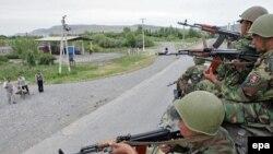 Kyrgyz soldiers patrol in Jalal-Abad on June 17.