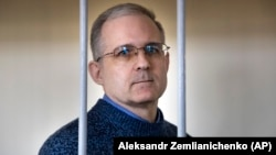 Paul Whelan stands in a cage while waiting for a hearing in a courtroom in Moscow on August 23.