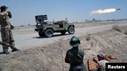 """قوات الحشد الشعبي تطلق صاروخاً على مواقع مسلحي """"داعش"""" في شمال الفلوجة"""