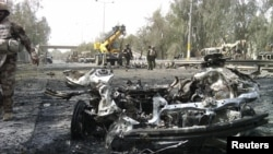 The remains of a vehicle used in the bomb attack outside Baghdad's Green Zone on April 18