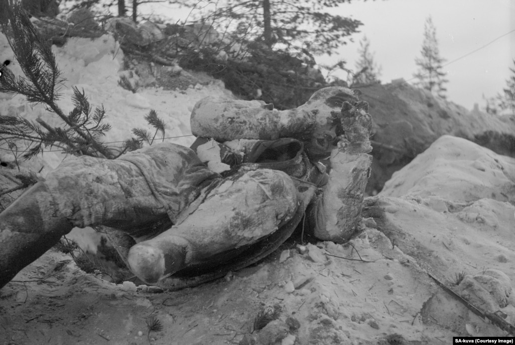 The frozen corpse of a Soviet soldier lies where he died.