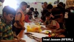 اطفال يرسمون ضمن مهرجان ألق الطفولة