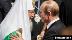 Patriarch Kirill (left) and Russian President Vladimir Putin (right) -- working together?
