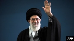 Iranian Supreme Leader Ayatollah Ali Khamenei waves to the crowd during a meeting in Tehran on February 17.
