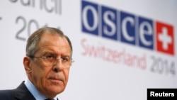 Глава МИД России Сергей Лавров (Базель, 5 декабря 2014 года)