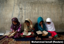 Afghan girls read the Koran at a madrasah. (file photo)