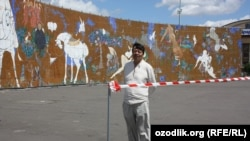 "Uzbekistan/Czech Republic - uzbek artist Lekim Ibrohimov near the painting ""One thousand angels and one painting"" in Prague exhibition area Vystaviste, 09 June 2012"