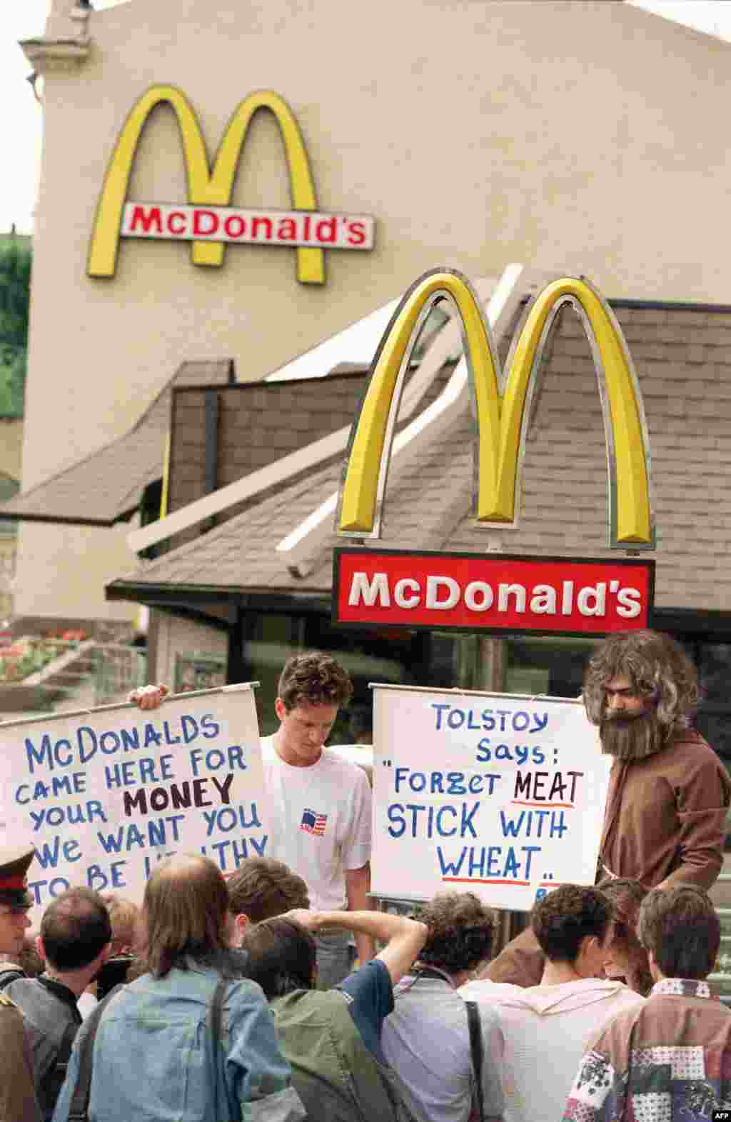 It wasn't all plain sailing for McDonald's in its early days in Russia. Here, Russian animal rights activists protest outside an outlet in 1992, claiming that meat is unhealthy for their compatriots.