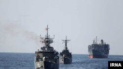 Iranian warships conduct military exercises.