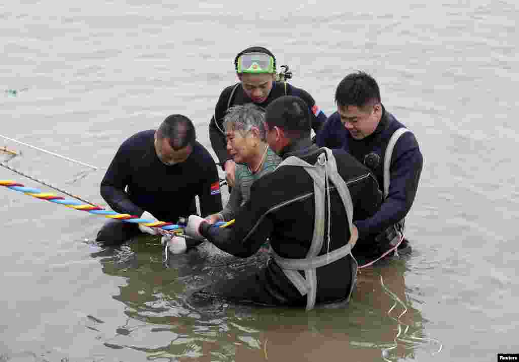 A passenger ship carrying 458 people, many of them elderly Chinese tourists, capsized on the Yangtze River on June 1. Only 13 people have so far been rescued, including this 65-year-old woman. (Reuters)