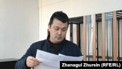 Гражданский активист Алибек Молдин на суде по его делу. Актобе, 22 ноября 2019 года.