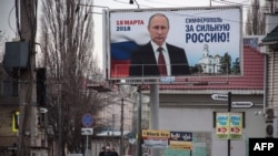 A campaign billboard for Russian President Vladimir Putin in the annexed Ukrainian peninsula of Crimea earlier this year.
