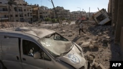 Разрушенные строения в Алеппо после бомбардировки