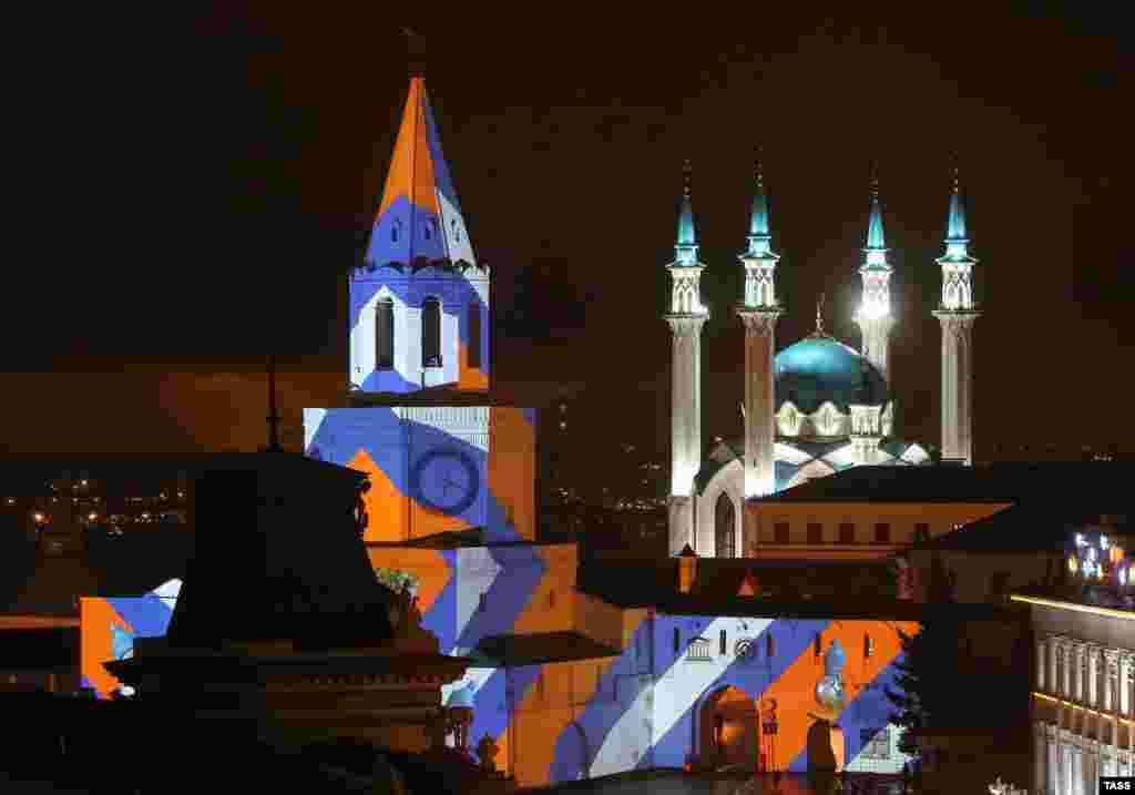 Projection mapping is shown on the Spasskaya Tower of the Kazan Kremlin. (TASS/Yegor Aleyev)
