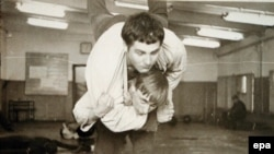 A young Vladimir Putin in a judo training fight at a St. Petersburg sports school in 1971.