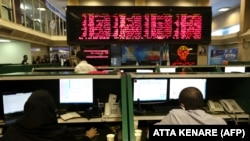 Iranian traders work at Tehran Stock Exchange on July 1, 2019. FILE PHOTO