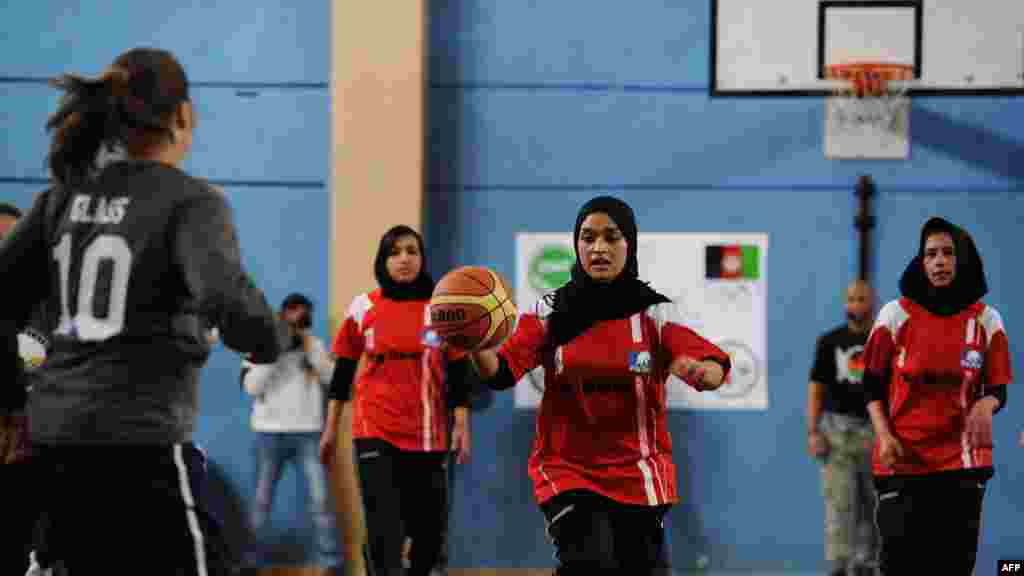 Afghanistan's women's Olympic basketball team plays a game with personnel from ISAF and the U.S. Embassy to mark International Women's Day in Kabul in March.