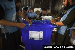 Independent Election Commission workers seal ballot boxes as they prepare for the upcoming presidential election at a warehouse in Kabul on September 16.