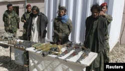 Afghan authorities present captured Taliban insurgents in Ghazni province last March. Now, local villagers from the same area have formed their own militia to take on the militants by themselves.