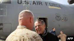 Afghanistan -- United States Secretary of Defense Leon Panetta is greeted after arriving at Camp Bastion, 14Mar2012