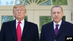 U.S. President Donald Trump (left) greets Turkey's President Recep Tayyip Erdogan at the White House in Washington on November 13.