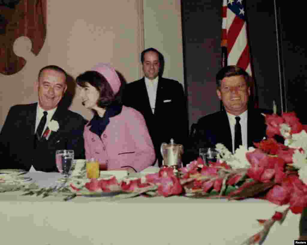 President John F. Kennedy attends a breakfast in Fort Worth, Texas with Vice President Lyndon Johnson and first lady Jacqueline Kennedy just hours before his assassination on November 22, 1963.