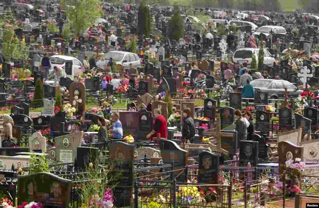 People gather on Radunitsa, or the Day of Rejoicing, at a cemetery on the outskirts of Minsk. The Orthodox Church holiday remembers the dead. (Reuters/Vasily Fedosenko)