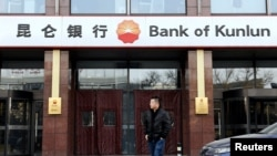 A man walks past a Bank of Kunlun branch in Beijing, China January 12, 2017. FILE PHOTO