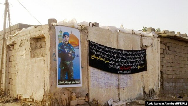 A poster on the home in Basra, Iraq, of Dhia Mutashar Gatie al-Issawi, an Iraqi who was fighting on behalf of the Syrian government before he was killed in Damascus.