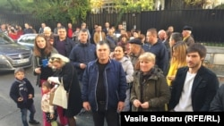 Thousands of Moldovans also voted at polling stations around Europe, including these people in Paris.