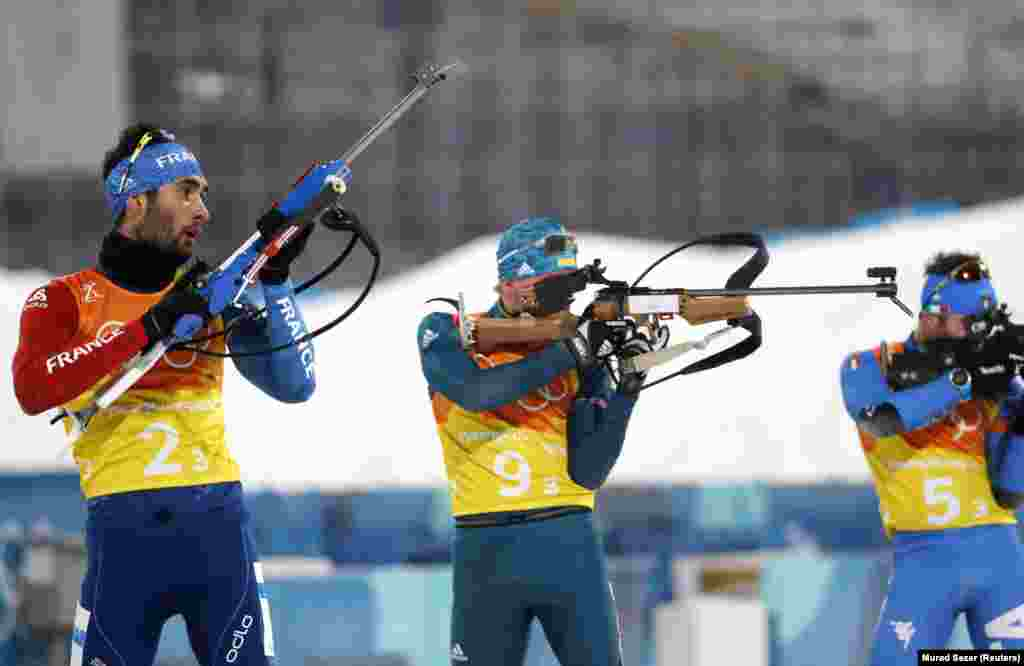 Biathlon: Martin Fourcade of France, Volodymyr Siemakov of Ukraine and Giuseppe Montello of Italy compete in Men's 4x7.5 km Relay Final at Alpensia Biathlon Centre during the Pyeongchang 2018 Winter Olympics, Pyeongchang, South Korea, February 23, 2018. Team of Sweden took gold in the discipline.