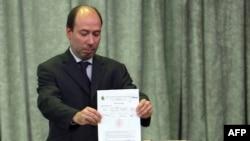 حسین شهرستانی وزیر نفت عراق در مراسم اعطای امتیاز بهره برداری از چند میدان نفتی در عراق