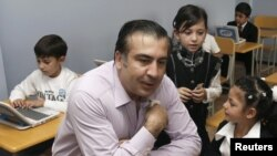 Georgian President Mikheil Saakashvili visits first-graders during their first lesson at the start of the new school year in September.