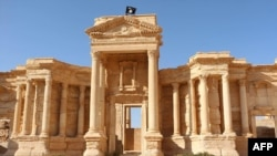 A video grab allegedly shows a flag of the Islamic State (IS) group at a Roman theater in the ancient city of Palmyra.