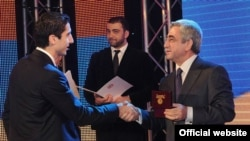 Armenia -- Henrikh Mkhitaryan is honored by President Serzh Sarkisian as Armenia's best football player of 2011, Yerevan, 15Dec2011