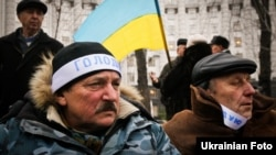 Ukrainian Chornobyl veterans rally in Kyiv near the government headquarters on December 1.