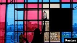 Ukraine - An employee decorates a window in a cafe before opening in Kharkiv, Ukraine, September 25, 2016