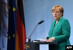 """Ангела Меркел """"Чоң жыйырманын"""" жыйынында."""