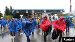 Хорватиядан Словенияға кіріп жатқан мигранттар. 19 қазан 2015 жыл.