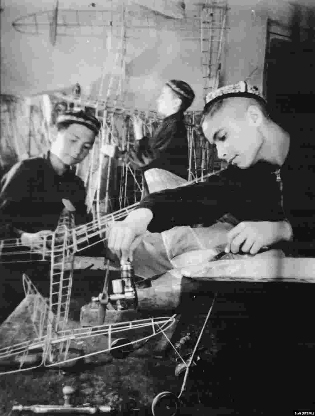 Islam Karimov (right) making a model airplane. In the 1940s the young Karimov, who would later lead the Uzbek Communists and then become Uzbekistan's first president, was sent to, then removed from, then finally sent back to an orphanage.