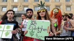 Activists gather during a rally in support of marijuana legalization in central Tbilisi.