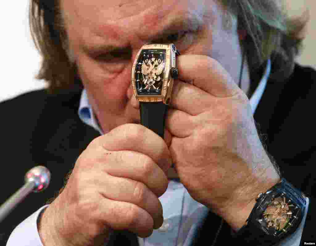 "French-born actor Gerard Depardieu attends a ceremony and news conference to present the luxury watch from the line ""Proud to be Russian"" in Moscow on December 17. (Reuters/Maxim Zmeyev)"