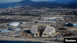 Under fire: an aerial view from March shows the Fisht Olympic Stadium (center) and other venues under construction for the 2014 Winter Olympic games in Sochi.