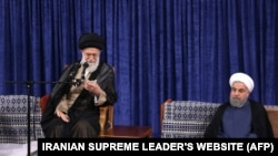 A handout picture released by the official website of the Iranian supreme leader Ayatollah Ali Khamenei shows him (L) speaking during the swearing in ceremony of Iranian President Hasan Rouhani (R) in Tehran on August 3.