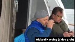 Milyarder Oleq Deripaska (solda) və Rusiya baş nazirinin müavini Sergey Prixodko yaxtada