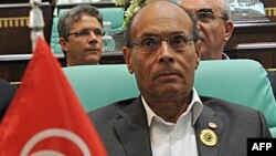 "Tunisian President Moncef Marzouki denounced the attack in Libya as a ""terrorist act."""