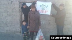 Семья, получившая помощь от казахской диаспоры во Франции (AKFT).