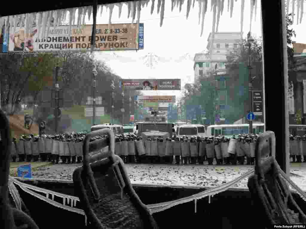 Icicles hang from a torched bus's windows following clashes overnight on January 19-20 between Ukrainian riot police and antigovernment protesters in Kyiv.