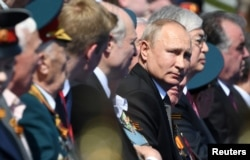 Russia's President Vladimir Putin attends the Victory Day parade in Red Square on June 24.