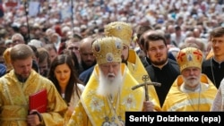 Thousands of followers of the Ukrainian Church of the Kyivan Patriarchate, led by Ukrainian Patriarch Filaret, perform a traditional cross-bearing procession to mark the Day of the Christianization of the Kievan Rus in Kyiv on July 28, 2017.
